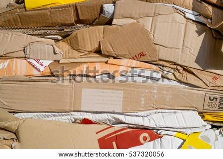Cardboard packaging crushed, pressed and stacked for recycling process