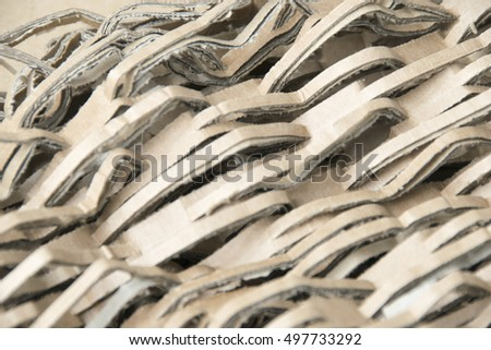 Cardboard pile on corrugated cardboard texture - shredding and recycling paper