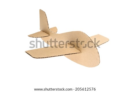 cardboard plane on white background - stock photo