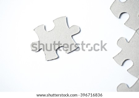 cardboard puzzles pieces on a white background - stock photo