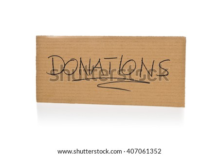 Cardboard sign for donations over white background with reflection - stock photo