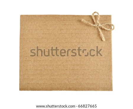 cardboard tag with bow isolated on white background - stock photo