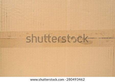 cardboard texture with tape - stock photo