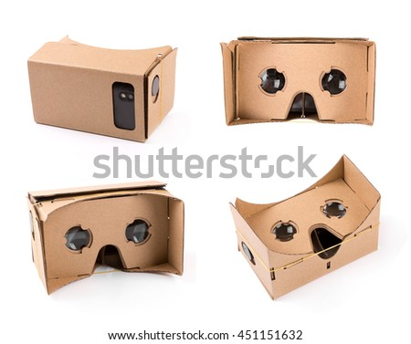 cardboard virtual reality glasses isolated on white - stock photo