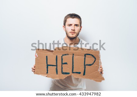 cardboard with text donate help. On a gray background. - stock photo