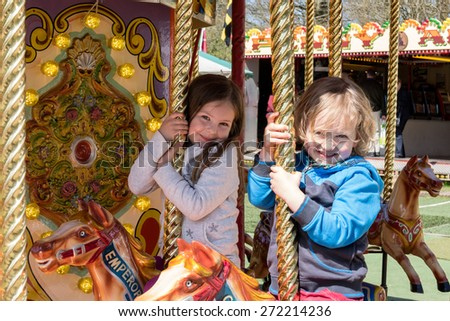 CARDIFF/UK - APRIL 19 : Children enjoying the carousel at St Fagans National History Museum in Cardiff on April 19, 2015. Unidentified children. - stock photo