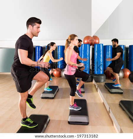 Cardio step dance people group at fitness gym training workout - stock photo