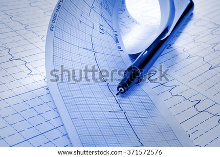 cardiogram and technical pen - stock photo
