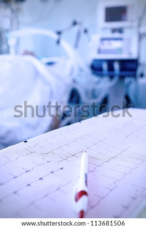 cardiogram, pen against the seriously ill in hospital - stock photo