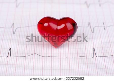 Cardiogram pulse trace and heart concept. Macro, shallow DOF. - stock photo