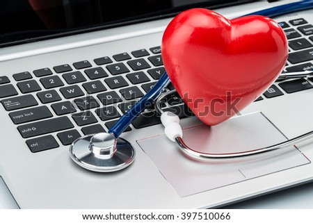Cardiologist, heart disease research, stethoscope and heart shape on laptop keyboard - stock photo