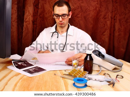 Cardiologist reads cardiogram test result, morphology and urine