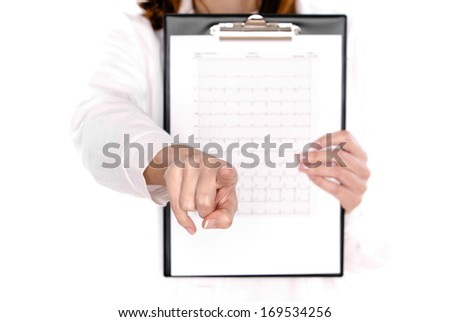 Cardiologist showing his patient EKG results - stock photo
