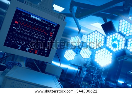 Cardiomonitoring of patient in operating room in hospital - stock photo