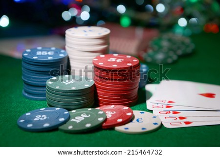 Cards and chips for poker on shiny background - stock photo