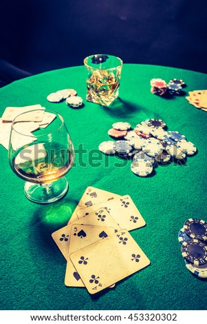 Cards and chips in vintage gambling table - stock photo