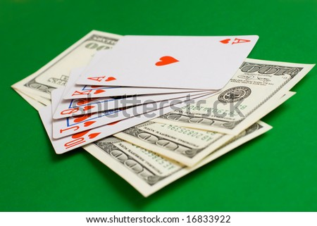 cards and money on a green cloth