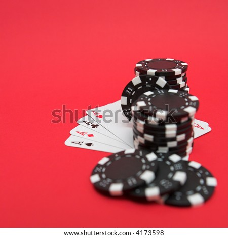 Cards & casino chips on red - shallow dof - stock photo