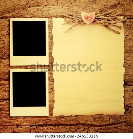 Cards for Valentine's Day or wedding,two frames for photos and parchment paper to write on wooden background - stock photo