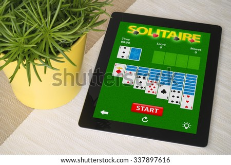 cards game app tablet. All screen graphics are made up - stock photo