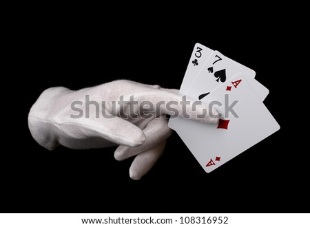 Cards in hand isolated on black