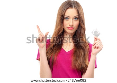 Care about your safety!  Beautiful young woman with long hair holding condom, isolated on white - stock photo