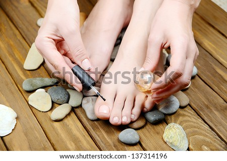 care for beautiful woman legs, Woman hand and feet with manicure , pedicure feet - stock photo
