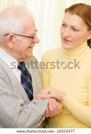 Care giver daughter holding hands her Father - stock photo