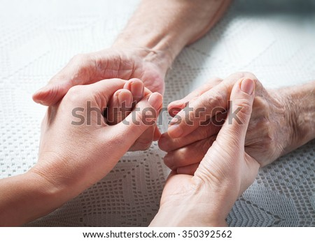 Care is at home of elderly. Senior man, with their caregiver at home. Concept of health caring for elderly old people, disabled. Elderly man.  - stock photo