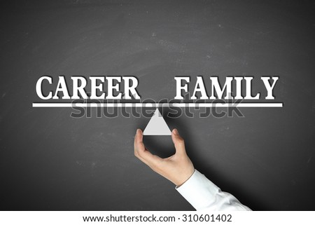 Career Family Balance concept with scale holden by businessman hand against the blackboard background. - stock photo