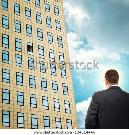 Career opportunity. Businessman facing company building, looking at open office window.