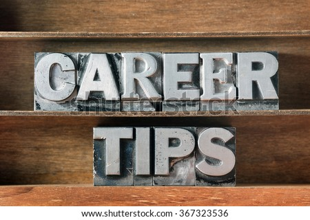 career tips phrase made from metallic letterpress type on wooden tray - stock photo