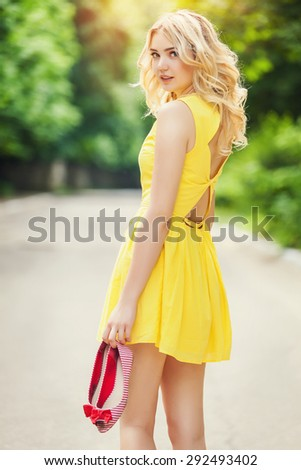 Carefree and free cheering woman in the park - stock photo