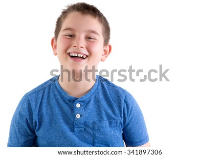 Carefree attractive young boy enjoying a good joke standing laughing at the camera, head and shoulders portrait isolated on white with copyspace - stock photo