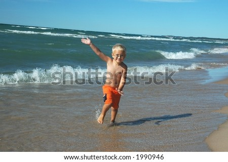 Carefree boy frolicking in the beach surf