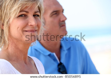 Carefree couples on vacation together - stock photo