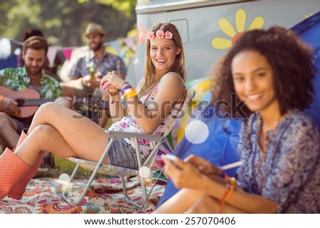 Carefree hipster relaxing on campsite at a music festival - stock photo