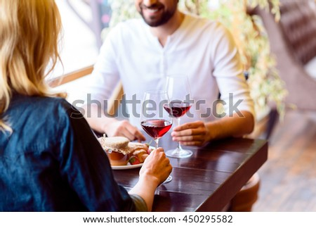 Carefree man and woman resting in cafe