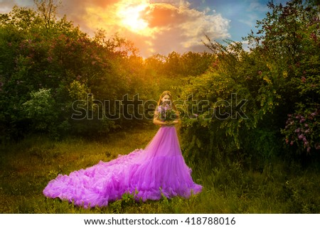 carefree woman dancing in the sunset on outdoors. vacation vitality healthy living concept