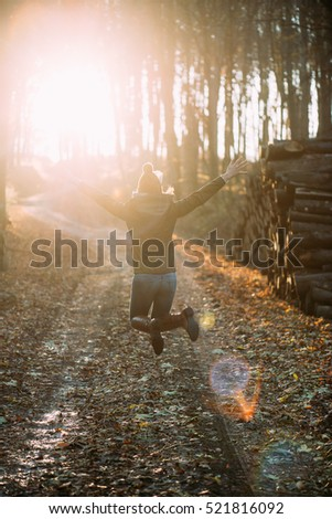 Carefree woman in forest