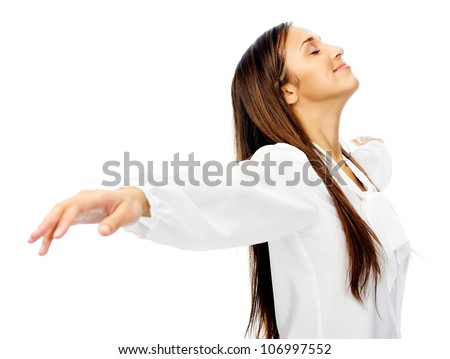 Carefree woman is stress free and holds her arms out for freedom and peace of mind. isolated on white background. - stock photo