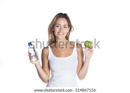 carefree woman with apple and water smiling with cheerful confidence isolated on white  - stock photo