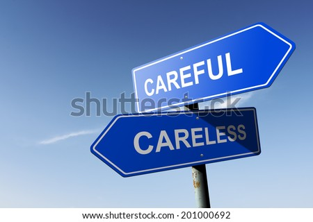 Careful and Careless directions.  Opposite traffic sign. - stock photo