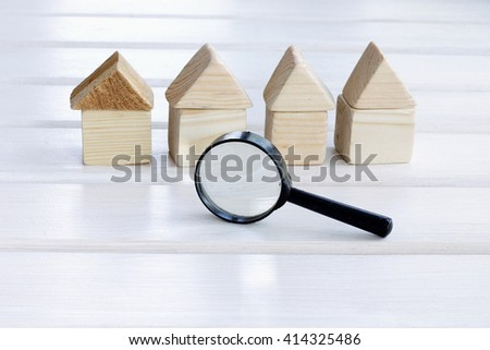 careful and picky choice of properties with a magnifying glass/search individual house - stock photo