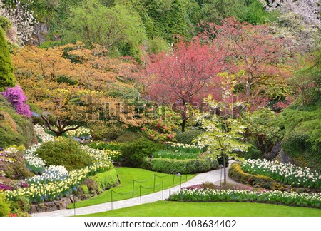 carefully gardened flower park at Butchart Gardens, Victoria, Vancouver Island, British Columbia, Canada - stock photo