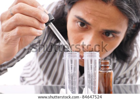 Carefully Mixing Chemical Solutions - stock photo