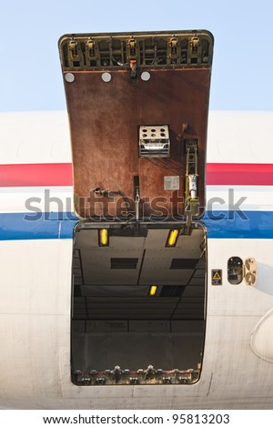 Cargo compartment door of an airplane at the airport - stock photo