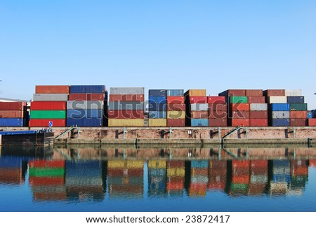 Cargo container in a harbour with water reflections