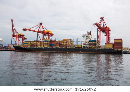 Cargo container ship at the dock - stock photo