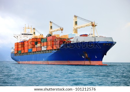 cargo container ship in mediterranean coast - stock photo